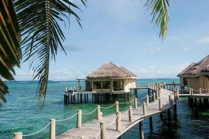 Overwater bungalow at Coconut Beach Resort and Spa.