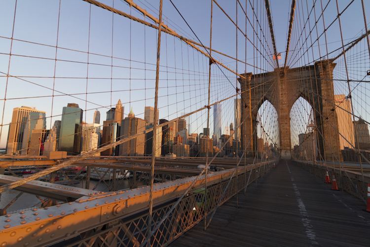 The Brooklyn Bridge at sunrise. Credit: iStock.com/dan_Germanboy.