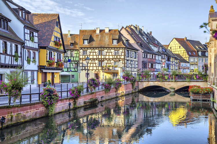Brightly coloured houses along the canals at Colmar. Credit: iStock.com/bbsferrari.