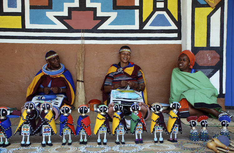 Ndebele women sell traditional dolls in Lesedi African Lodge and Cultural village, South Africa. Credit: iStock.com.