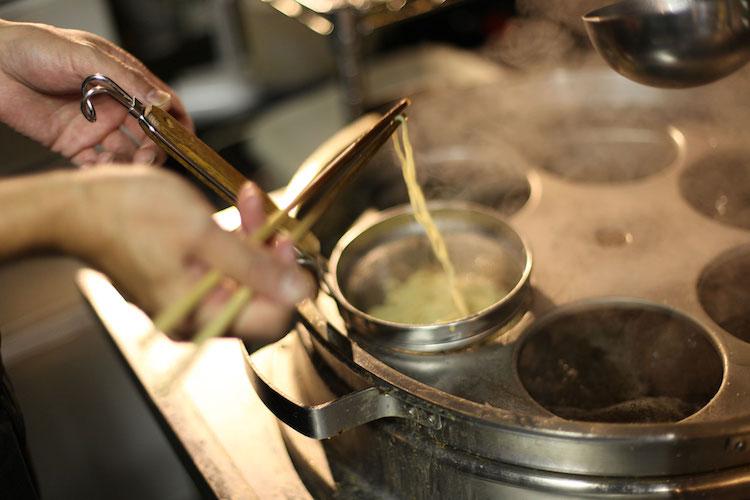 Making ramen at Yakimen Tsuguri, Tokyo. Credit: Tim Lambourne.