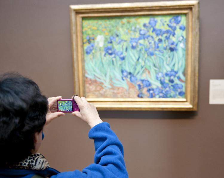 A woman photographs Vincent Van Gogh
