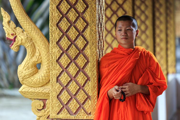 A monk at a Buddhist temple, Luang Prabang. Credit: iStock.com