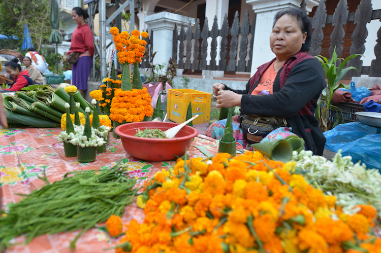 A flower seller at the morning market. Credit: iStock.com