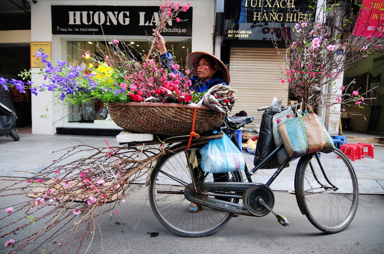 A vendor at a street market in Ho Chi Minh City (Saigon). Credit: iStock.com