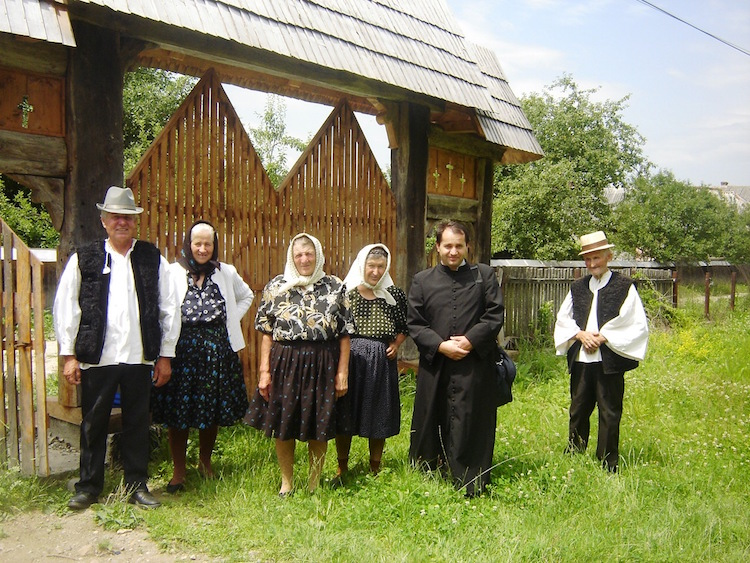 In their Sunday best, Cornesti villagers assemble outside their wooden church. Photo: Diana Noonan