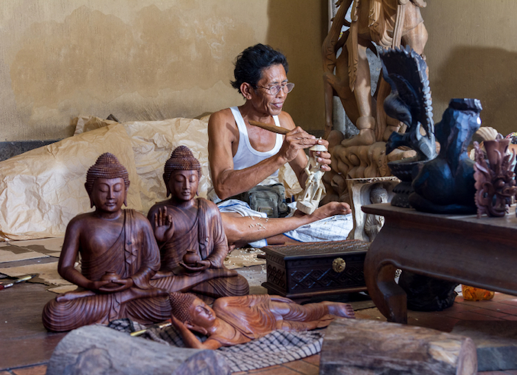 An artisan wood carver at work, Ubud. Photo: iStock