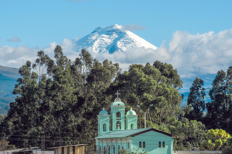 Cotopaxi Volcano with San Jaloma Church in the foreground. Photo: iStock
