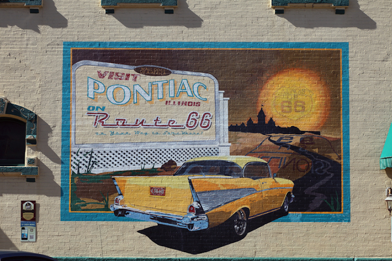 Pontiac wall mural showing a yellow 1955 Chevrolet Bel Air driving on Route 66