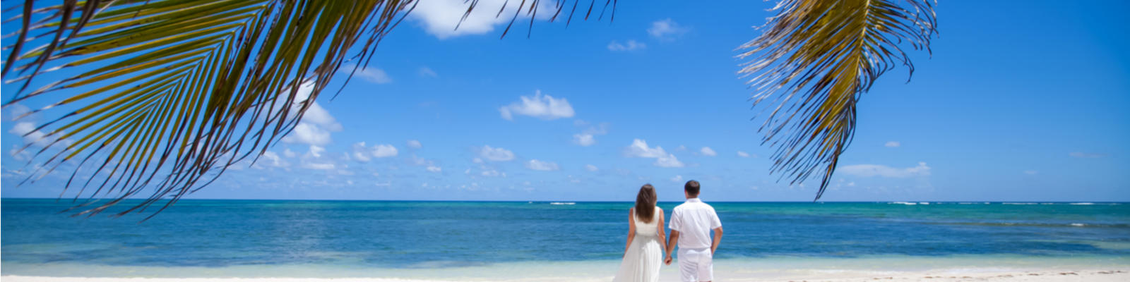 Wedding couple on beautiful white sand beach (Shuttterstock)