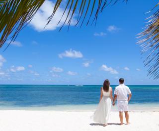 Wedding couple on beautiful white sand beach (Shuttterstock)